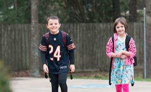 Two happy students entering school; The Branch School; Private School in Houston