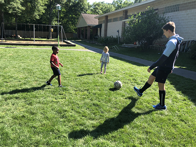 Branch School students playing soccer together